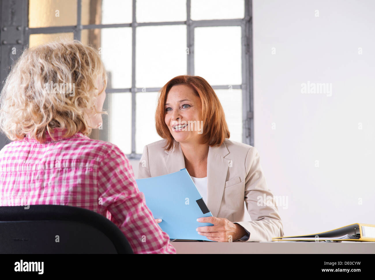 Personnel manager during an interview with a trainee Stock Photo