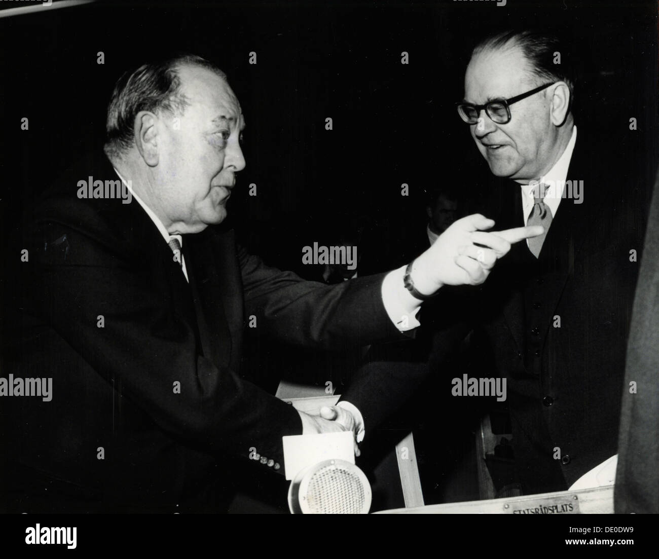 Trygve Lie, Norwegian politician, and Tage Erlander, Prime Minister of Sweden, 15 February 1964. At a meeting of Nordic Council. Lie (1896-1968) served as Foreign Minister of Norway from 1941 until 1946, when he was appointed the United Nations' first Secretary General, a post he held until 1952. He was Norway's Minister of Trade and Shipping at the time of this photograph. Erlander (1901-1985) was Sweden's Prime Minister from 1946 until 1969. From the collection of Svenskt Fotoreportages. - Stock Image