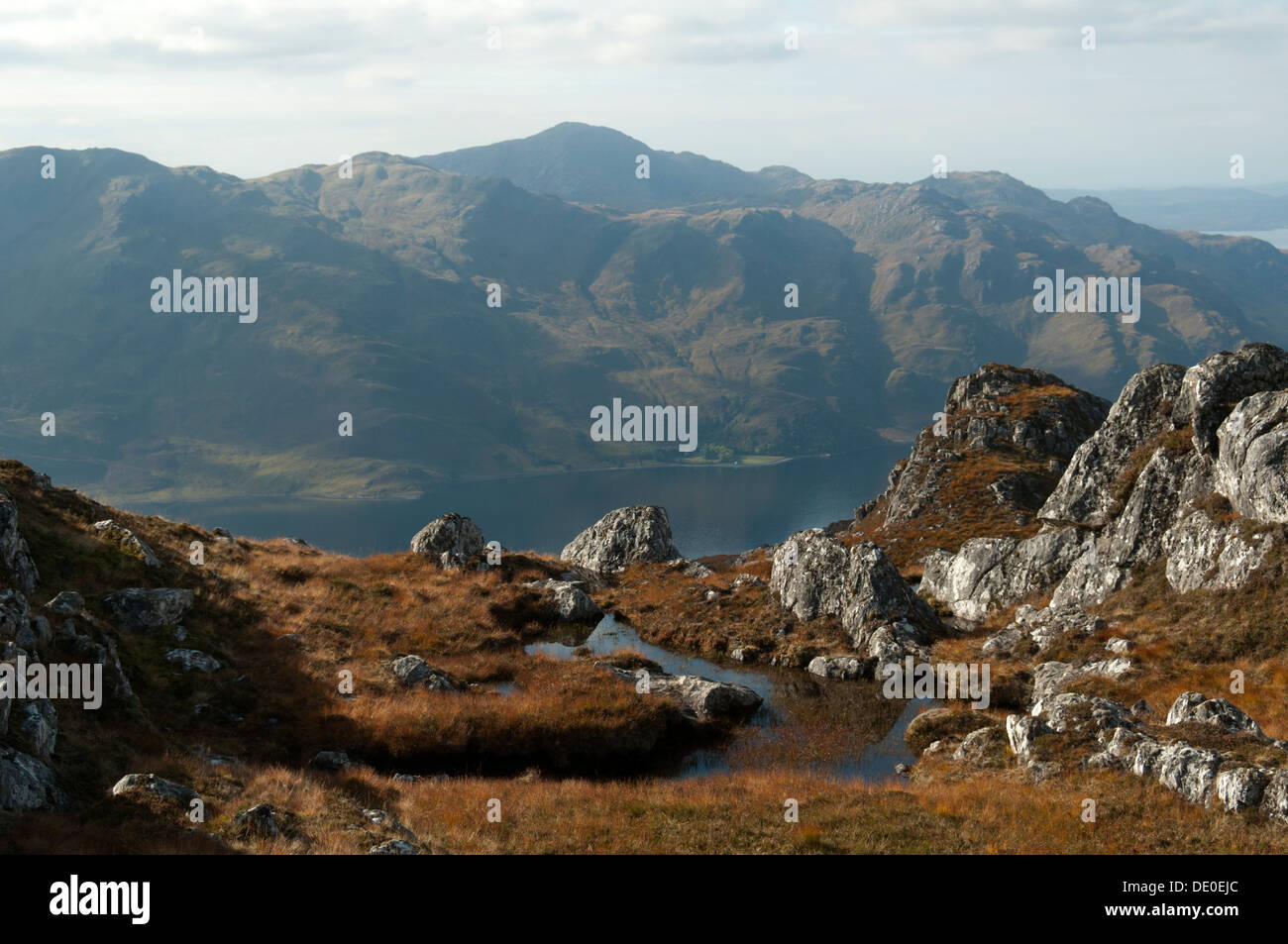 Beinn na Caillich and the peaks of Knoydart over Loch Hourn, from the ridge of Druim Fada, Highland region, Scotland, Stock Photo