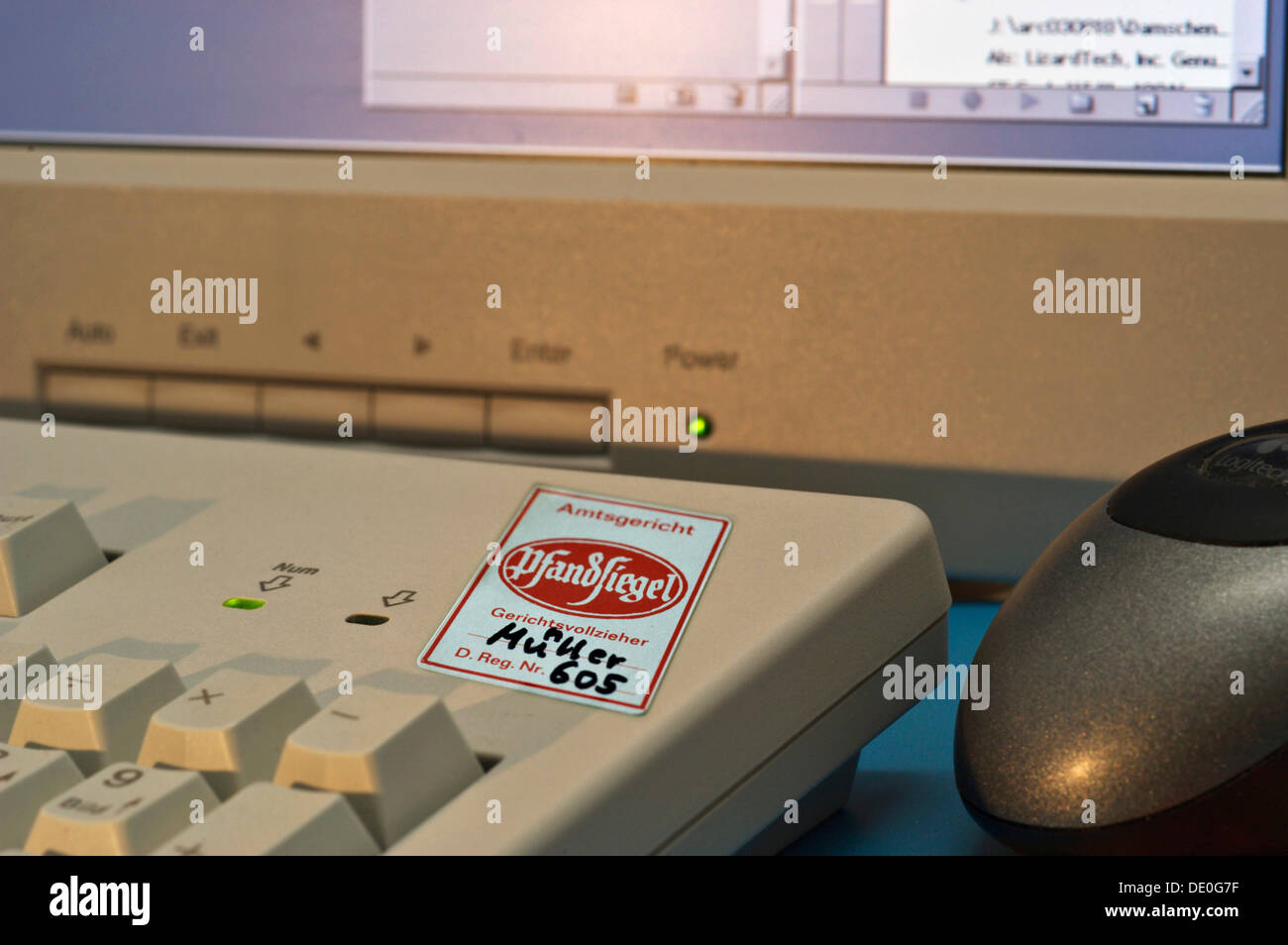 Computer workstation with a deposit stamp on the keyboard - Stock Image