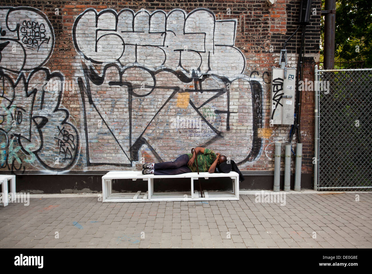 indigent sleeping, Street art on Houston Street, Manhattan, New York, United States of America - Stock Image