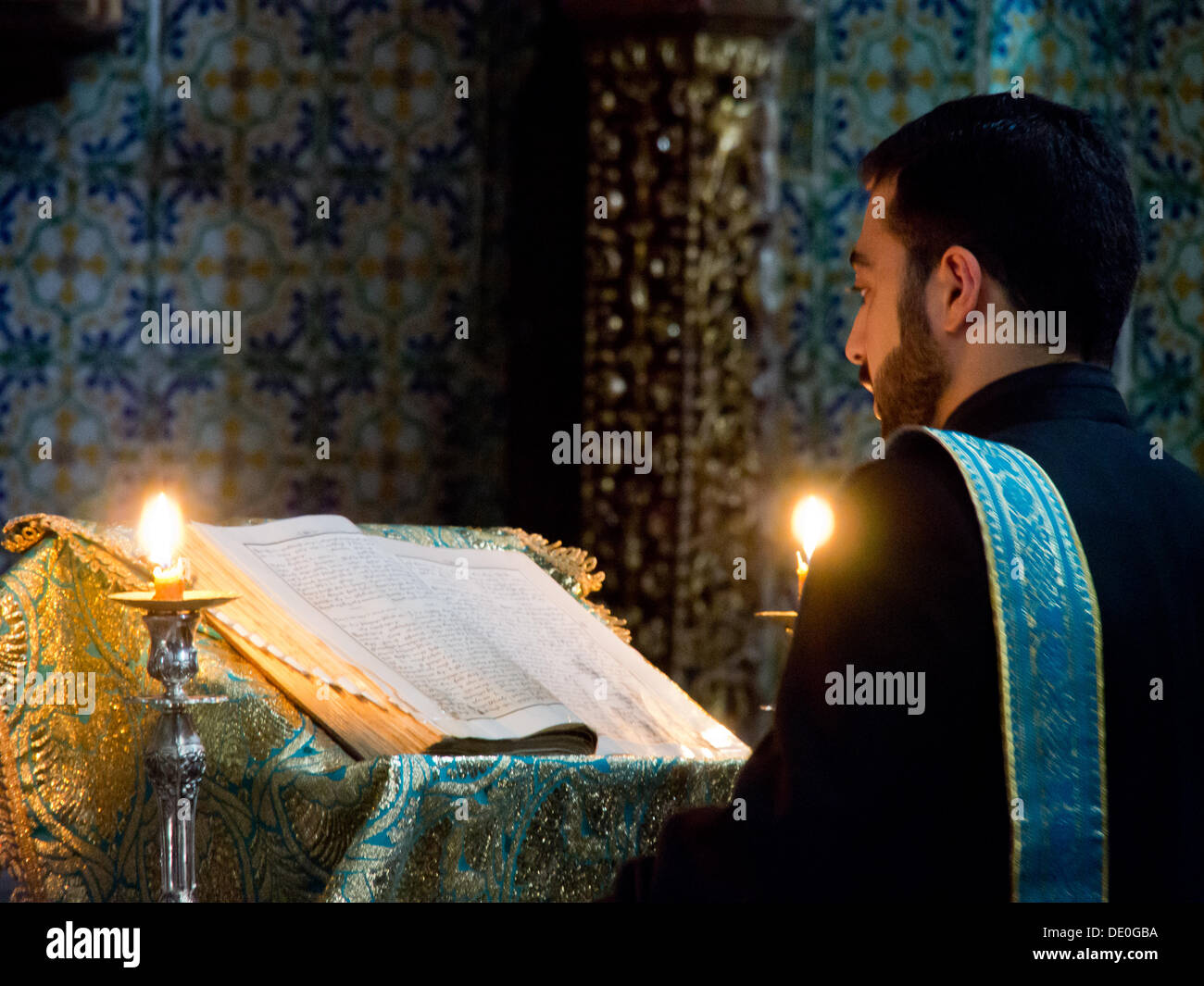 A priesthood trainee leads vespers at the Armenian Cathedral of St. James in Jerusalem. Although legislation describes Israel as a 'Jewish' state it also provides for freedom of worship which is respected in practice. - Stock Image