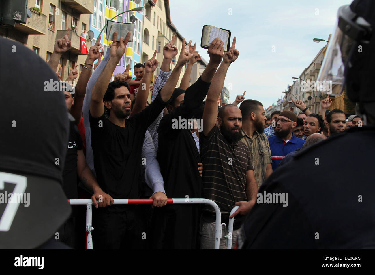 Protest against an anti-Islamic rally by the minor political party Pro Deutschland in front of a mosque in Berlin-Neukoelln, - Stock Image