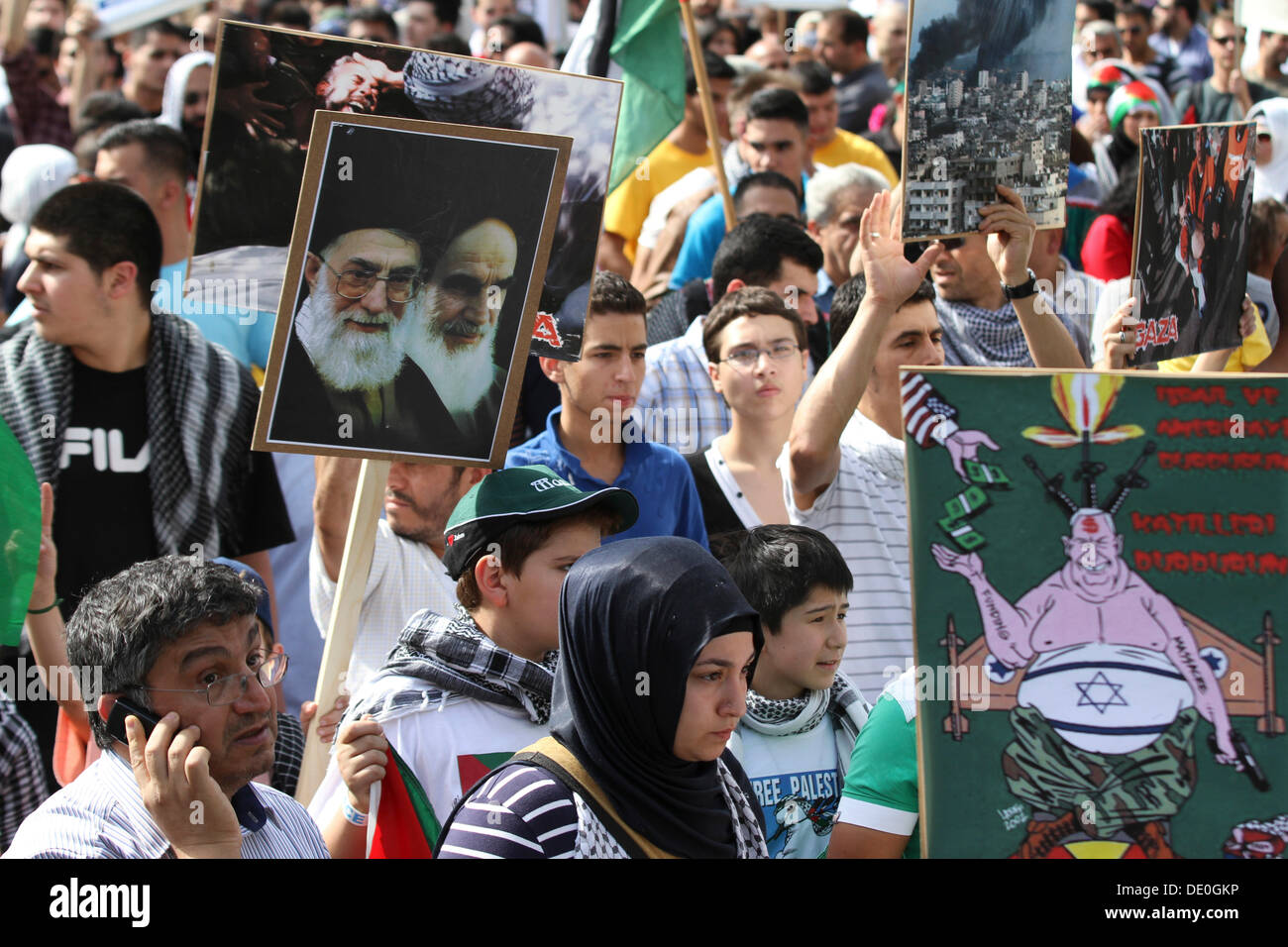 Anti-Israel Al-Quds Day demonstration with hundreds of participants protesting through Charlottenburg, Berlin - Stock Image