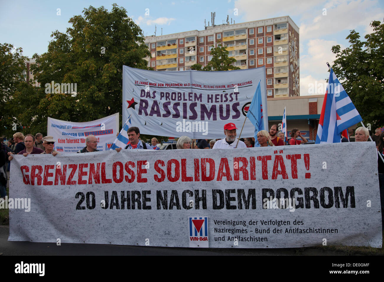 Thousands of people protesting against racism, Sonnenblumenhaus building at the back, where the massive right-wing riots took - Stock Image