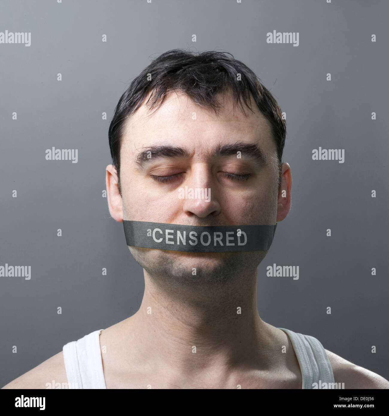 man's portrait with bandage on his face which represents censorship of statements - Stock Image