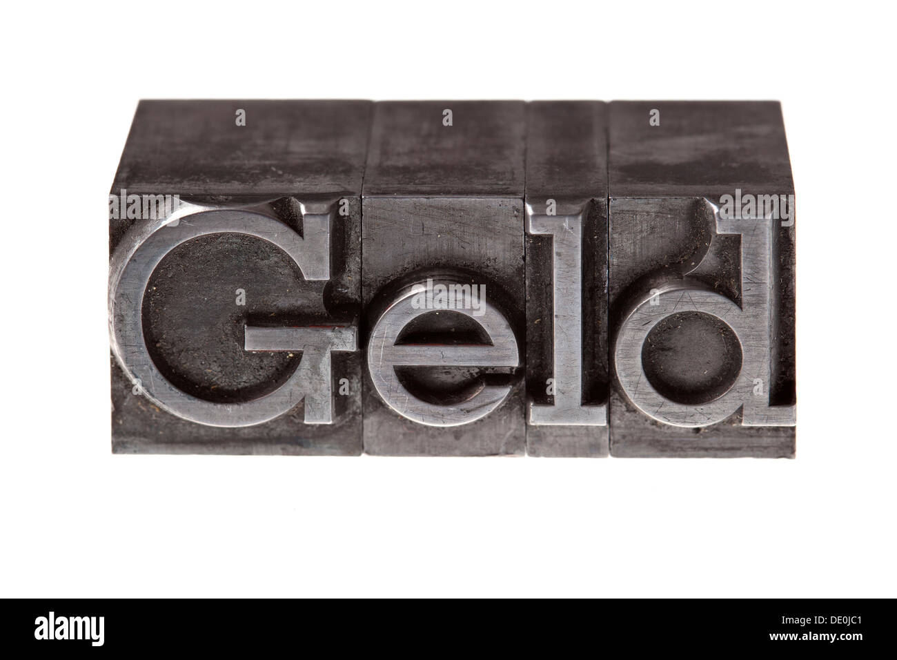 Old lead letters forming the word 'Geld', German for 'money' - Stock Image