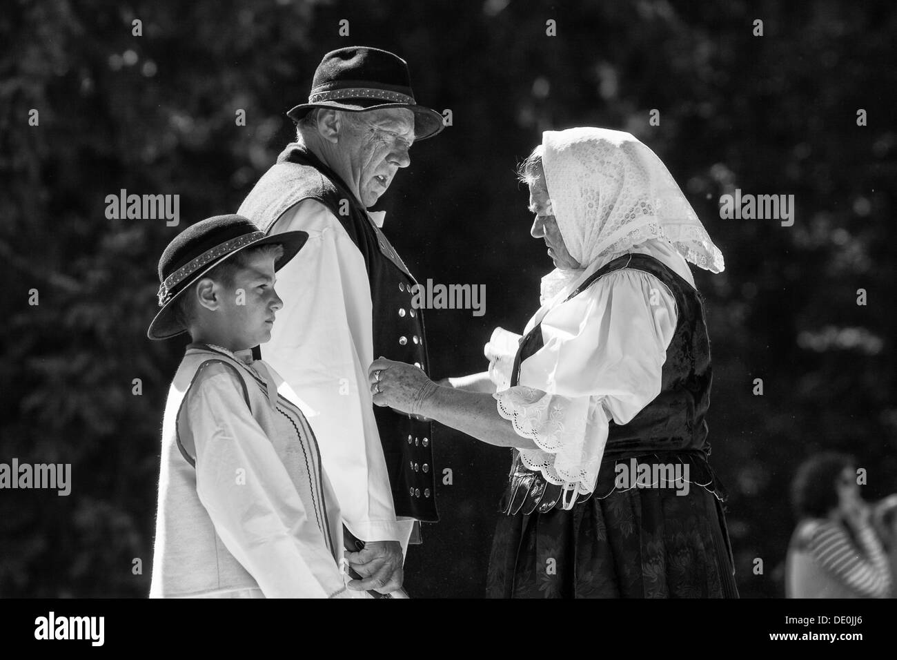 Folklore family - man woman and son - Stock Image
