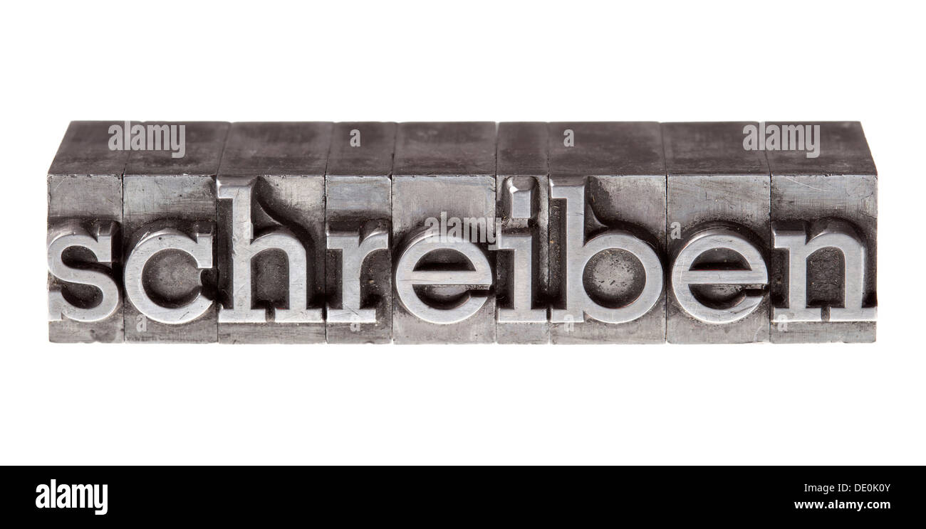 Old lead letters forming the word 'schreiben', German for 'to write' - Stock Image