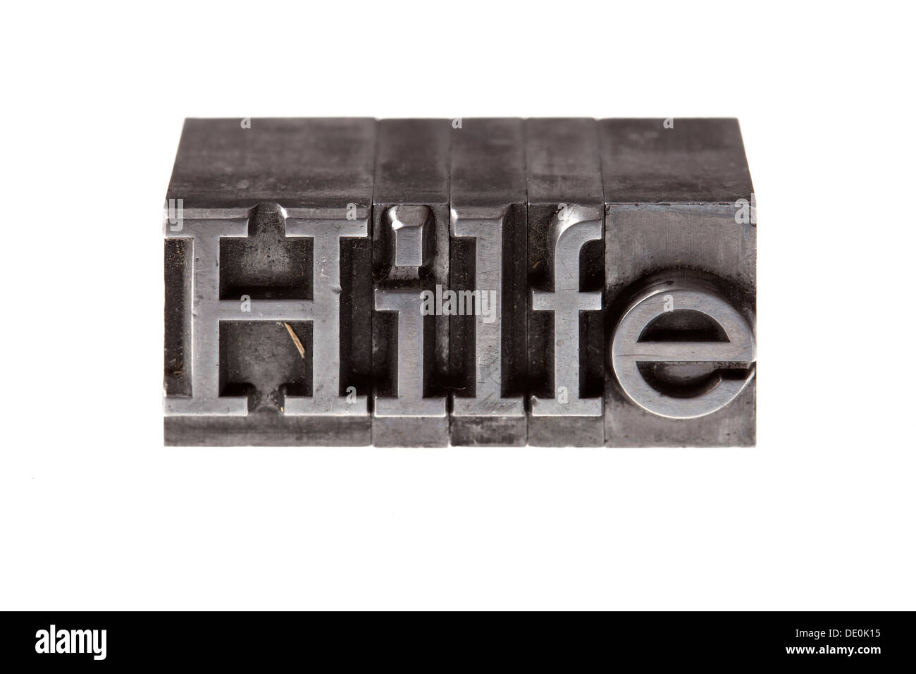 Old lead letters forming the word 'Hilfe', German for help - Stock Image