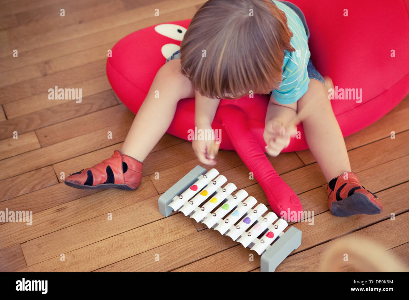 Little boy playing toy xylophone - Stock Photo