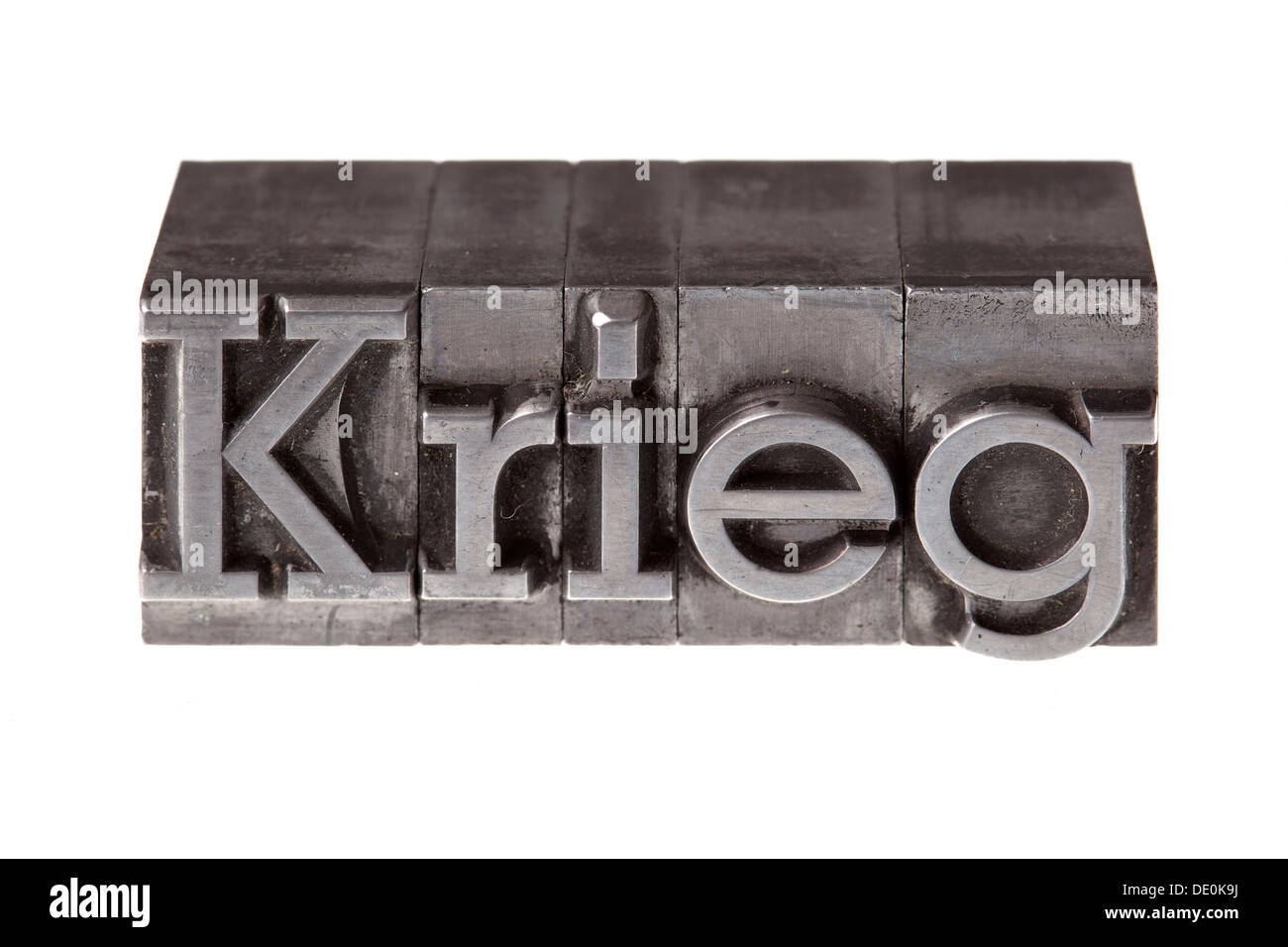 Old lead letters forming the word 'Krieg', German for war - Stock Image