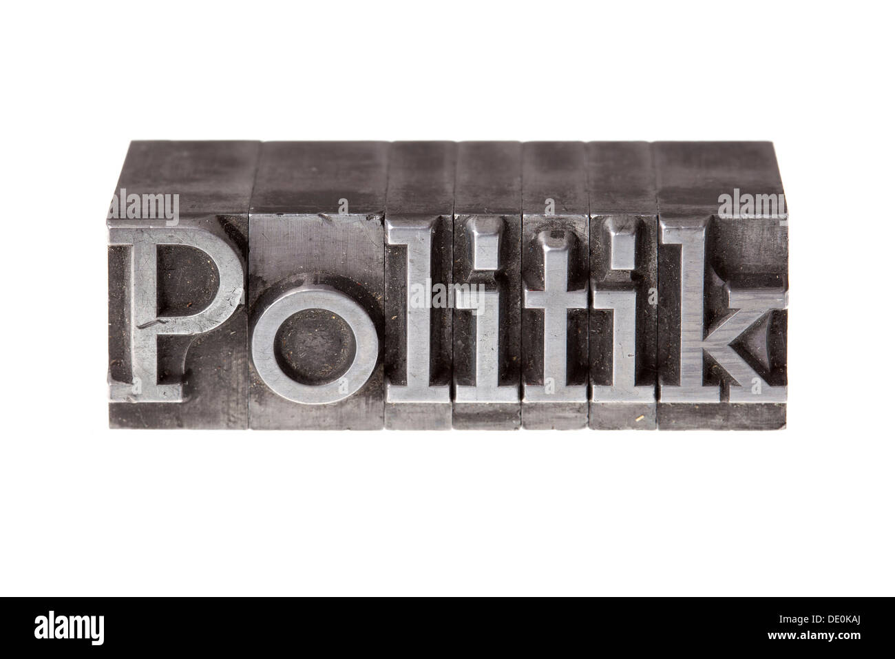 Old lead letters forming the word 'Politik', German for politics - Stock Image