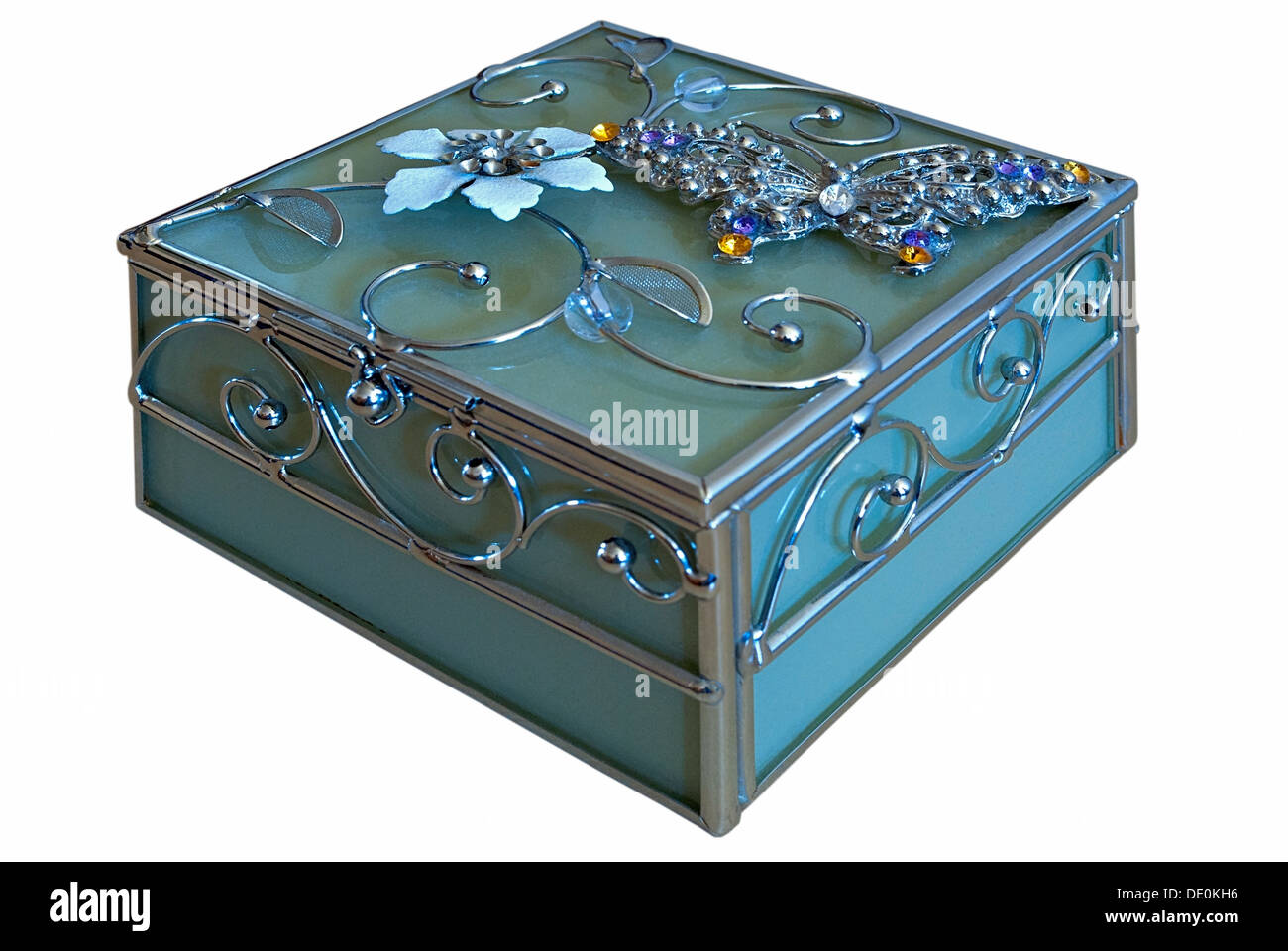 Casket of blue glass with a pattern in the form of a flower, isolated on white background. - Stock Image
