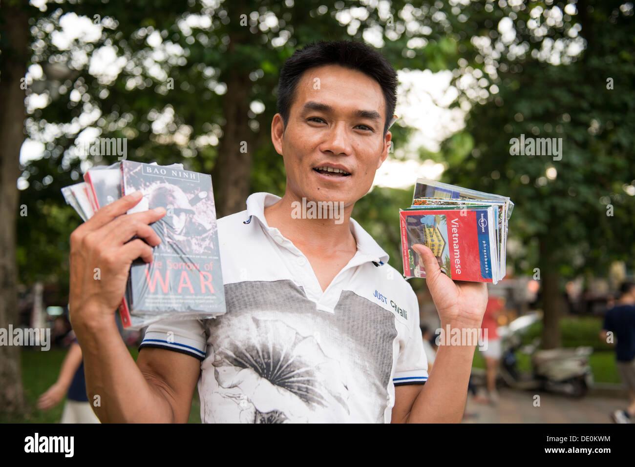 Paddling book seller in Hoan Kiem lake side, Hanoi, Vietnam - Stock Image