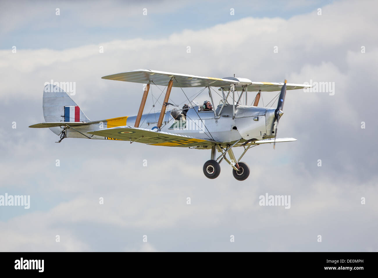 De Havilland Tiger Moth biplane in flight, side view - Stock Image