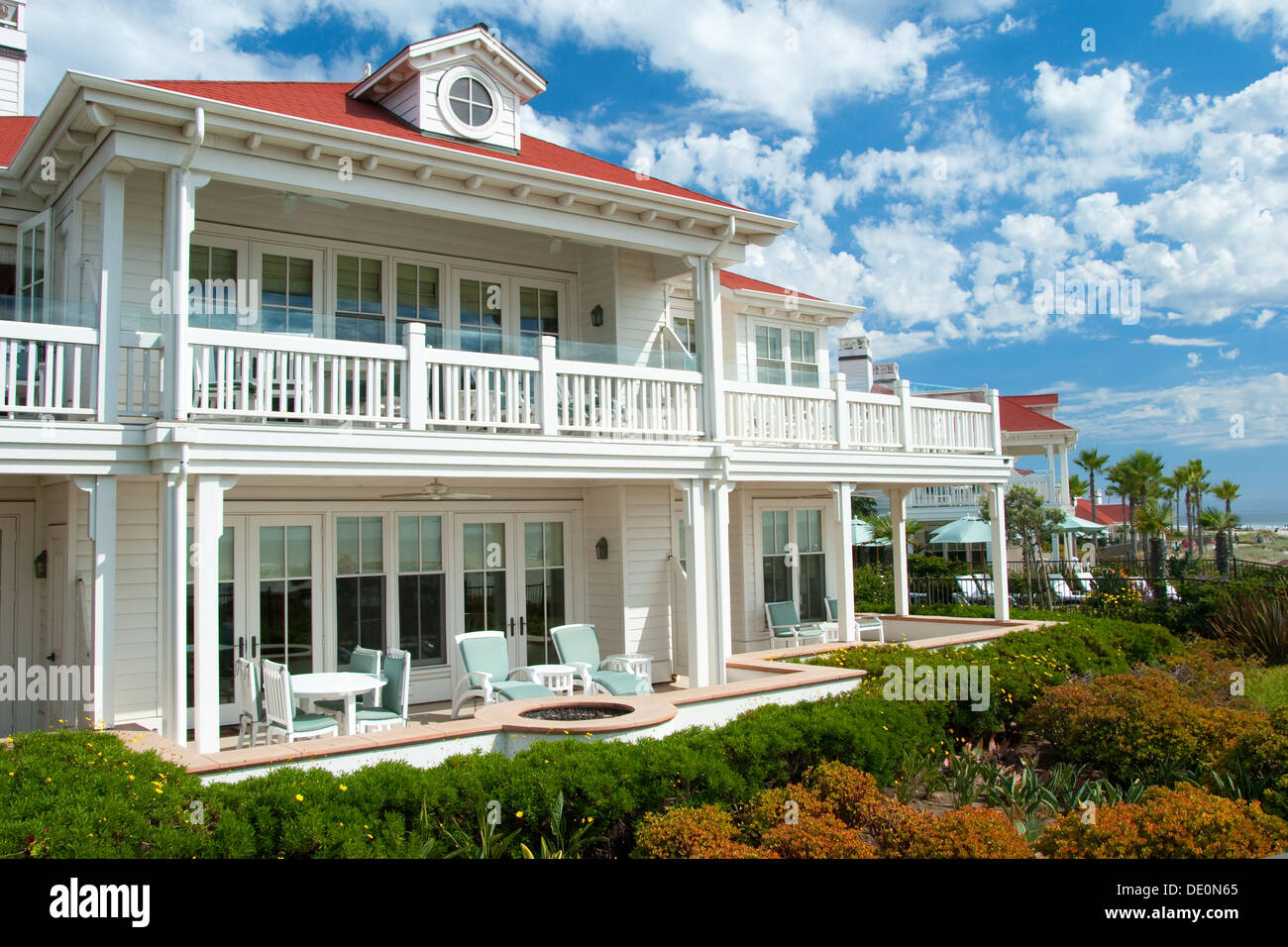 Luxury american dream beach summer house with beautiful blue sky in background. - Stock Image