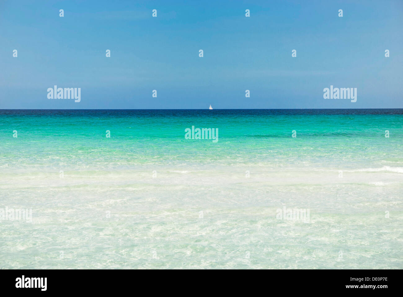 Horizon with sailing ship, turquoise sea with sandy beach, La Cinta, Sardinia, Italy, Europe - Stock Image