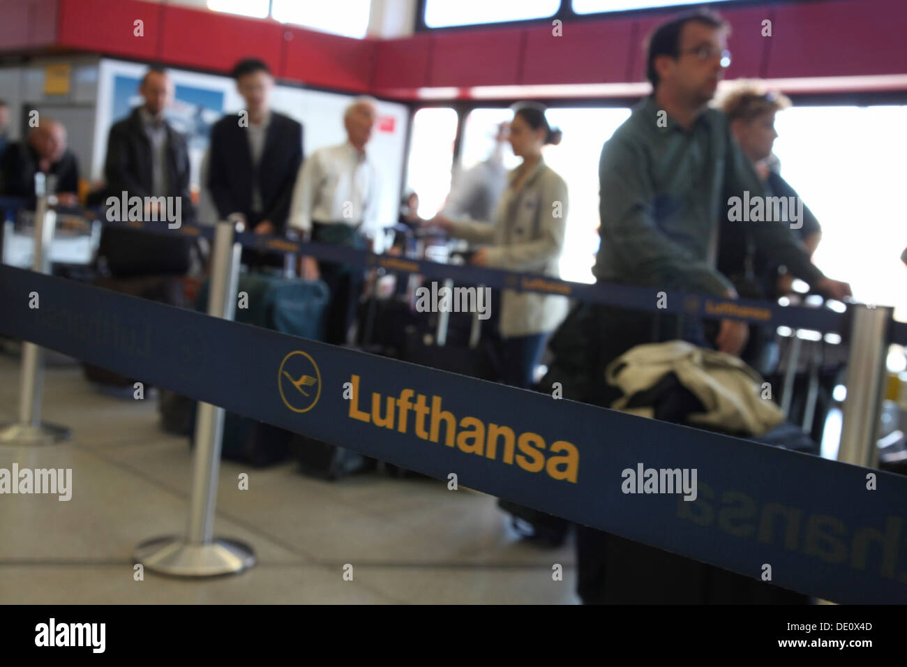 Passengers waiting at the airport, delays and canceled flights due to the strike of the Lufthansa flight attendants - Stock Image