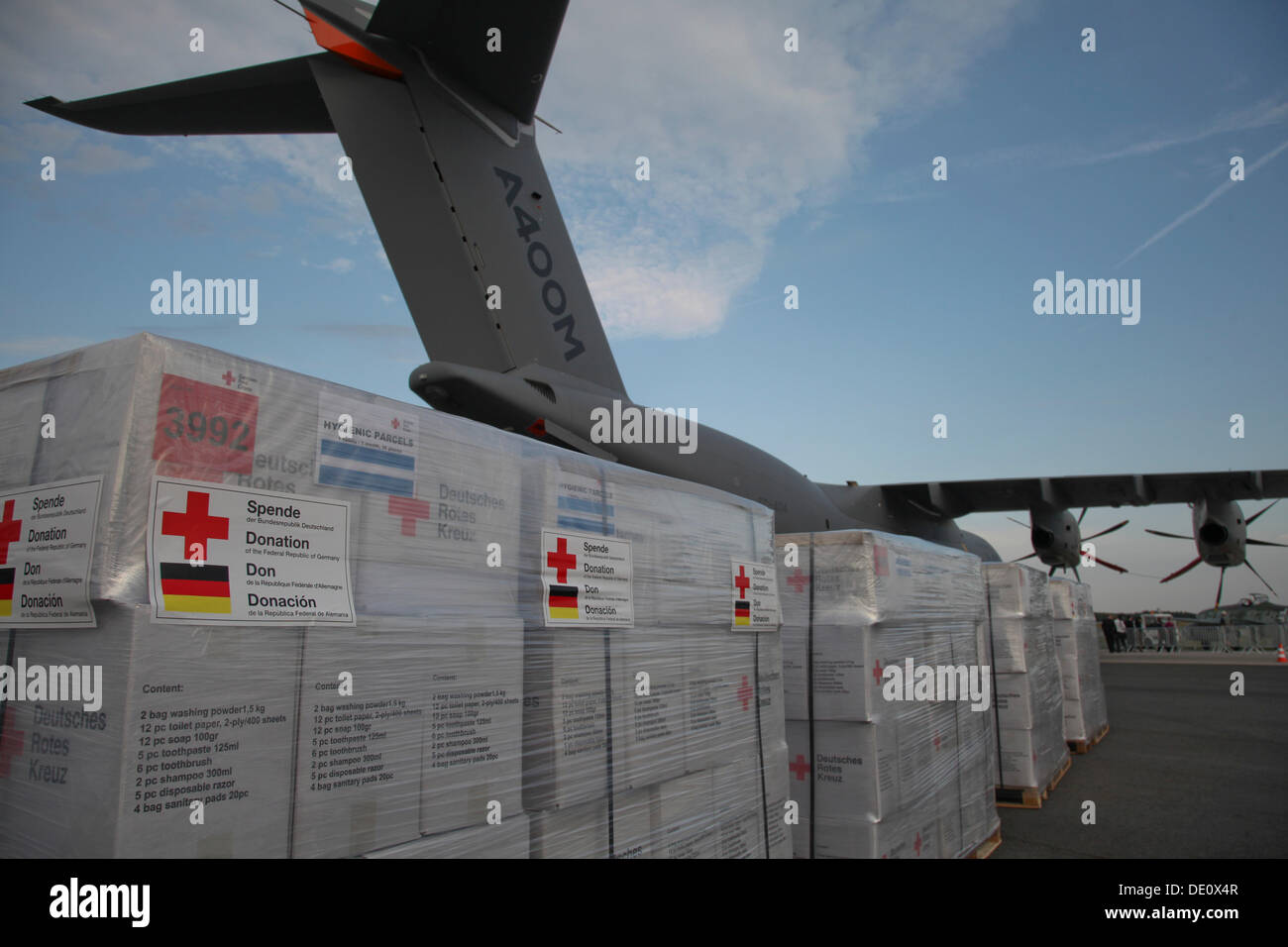 Relief supplies in front of an Airbus A400M Atlas, ILA Berlin Air Show, Berlin - Stock Image