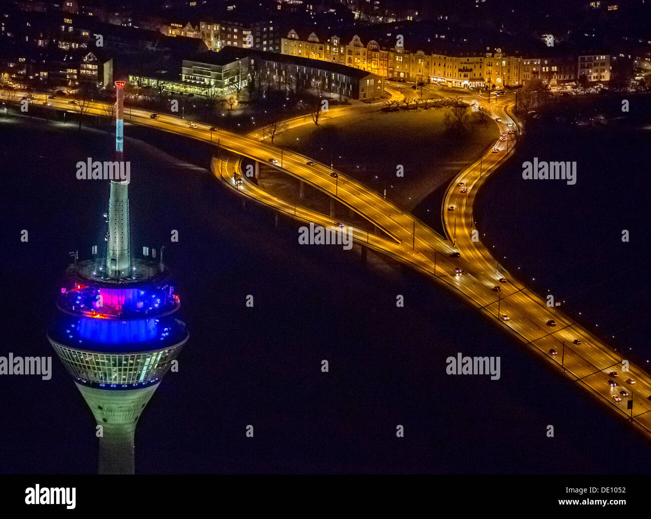 Aerial view, TV tower and the left bank of the Rhine River, Oberkassel, night scene, Duesseldorf, Rhineland - Stock Image