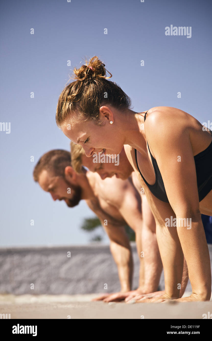 Muscular active people in 20s training to maintain healthy lifestyle. - Stock Image
