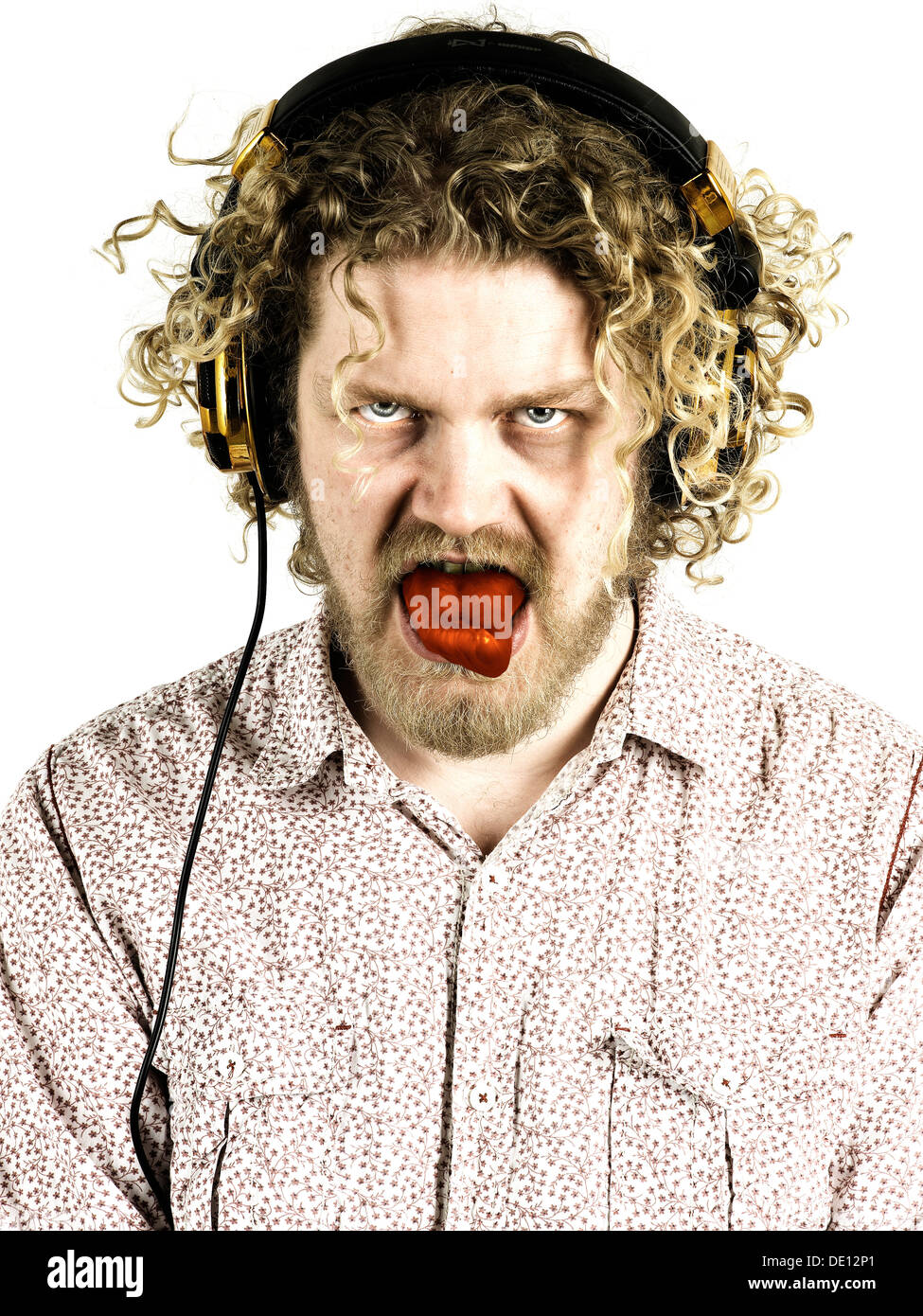 young man furious evil looking with a huge tongue - Stock Image