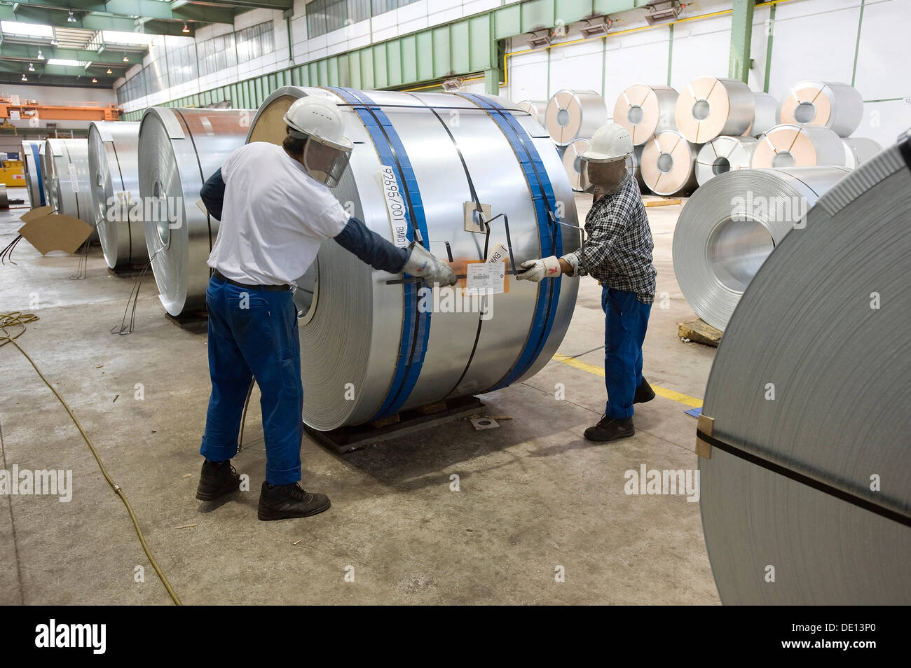 Packaging of galvanised or zinc-coated sheet metal wound into coils for the automotive industry, galvanising line - Stock Image