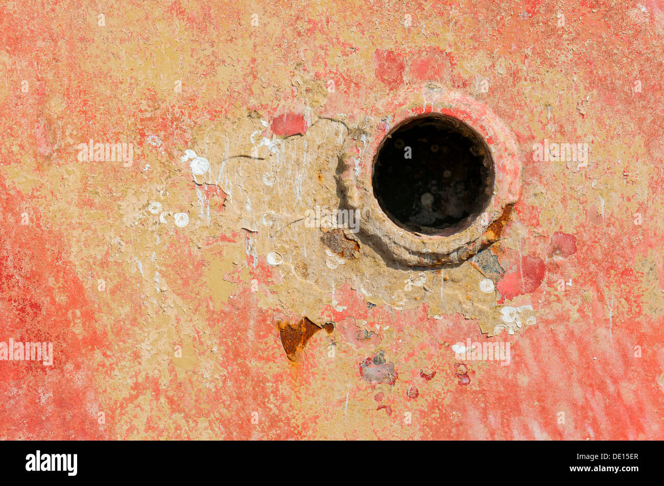 Plughole, paint coming off in flakes - Stock Image