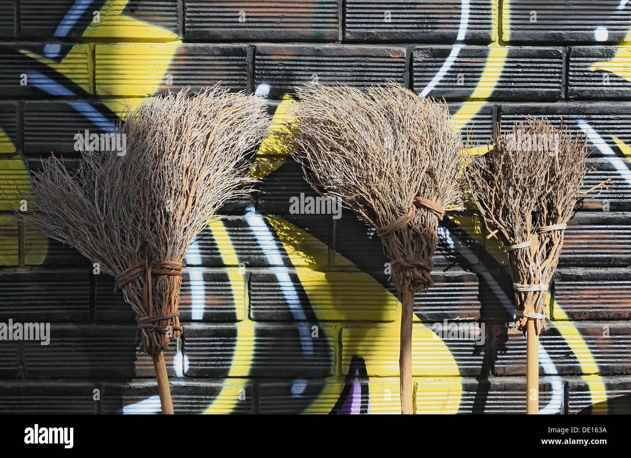 Three Broomsticks, handicrafts, straw broom, broom - Stock Image
