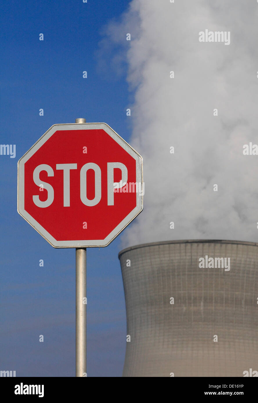Symbolic image against nuclear power, stop sign in front of a cooling tower of Gundremmingen Nuclear Power Plant Stock Photo