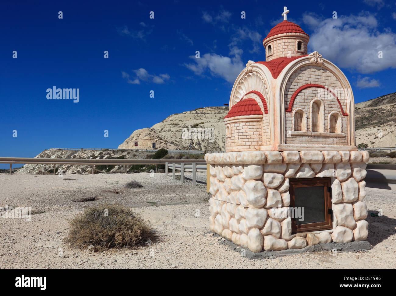 Cyprus, small chapel in a parking lot near Petra tou Romiou, coastal road, parking - Stock Image