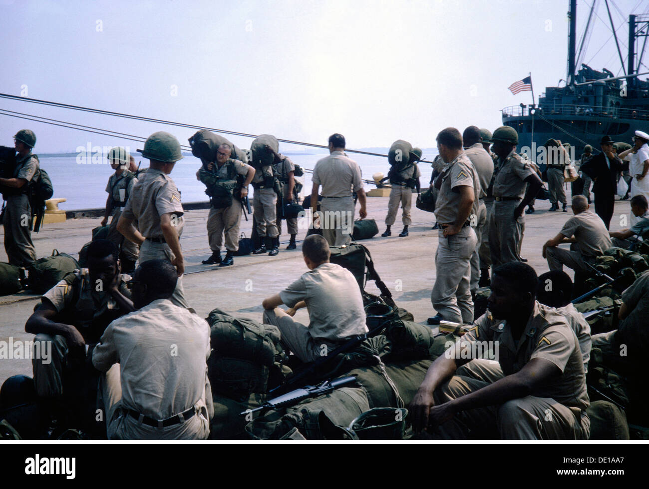 Vietnam War 1957 - 1975 arrival of American troops South Vietnam 1965 harbour harbor harbours harbors port ports baggage - Stock Image