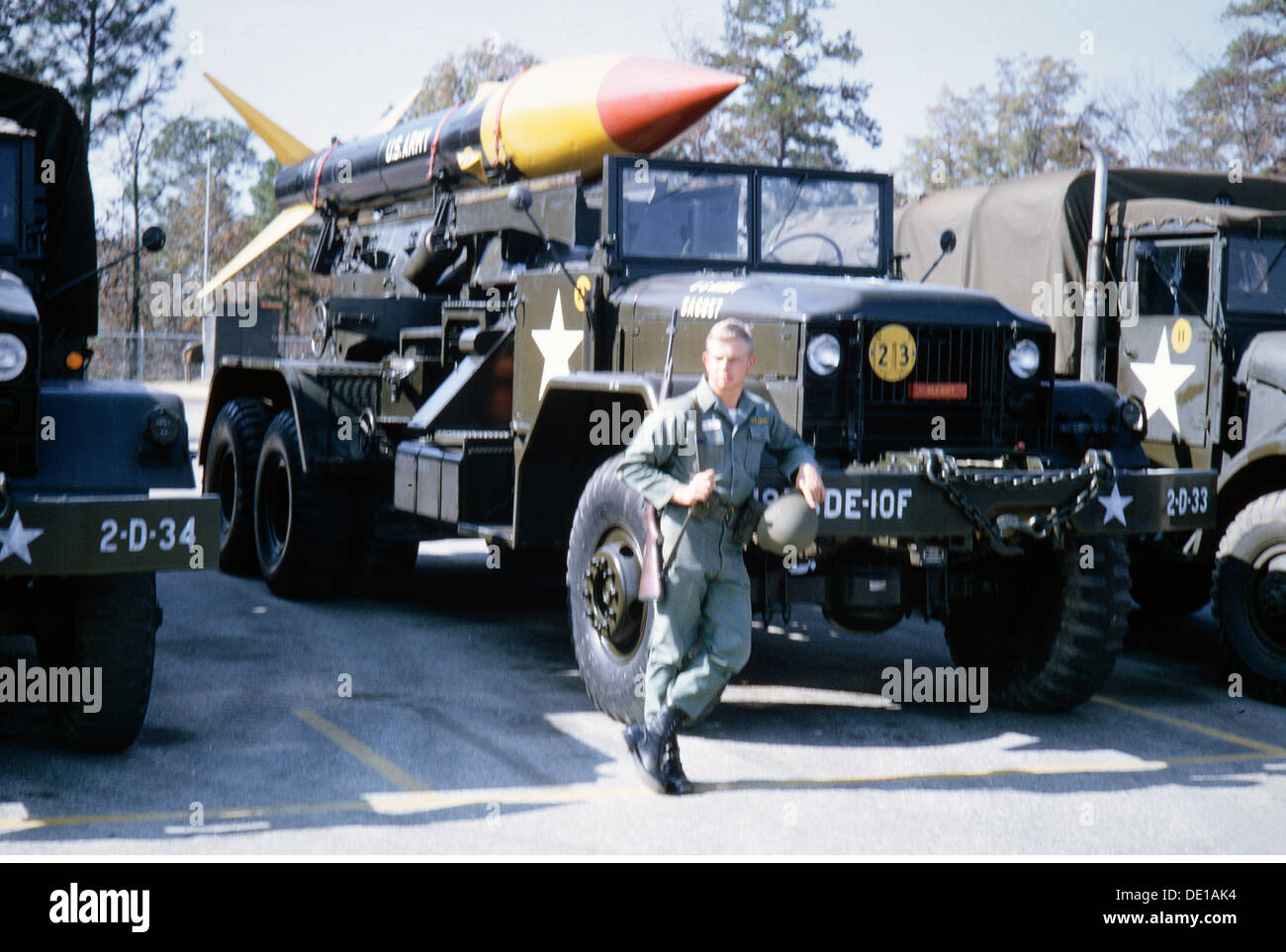 military, USA, army, missile artillery, the German soldier Dierk Piffko besides a MGR-1 Honest John short-range missile, 1964, nuclear missile, nuclear missiles, launching vehicle, firing platform, lorries, trucks, lorry, truck, SRBM, MGR1, MGR 1, rocket, rockets, uniform, uniforms, soldier, soldiers, armed forces, 1960s, 60s, 20th century, people, man, men, male, nuclear weapon, nuke, nuclear weapons, nukes, USA, United States of America, army, armies, short-range missile, short-range missiles, historic, historical, Additional-Rights-Clearences-NA - Stock Image
