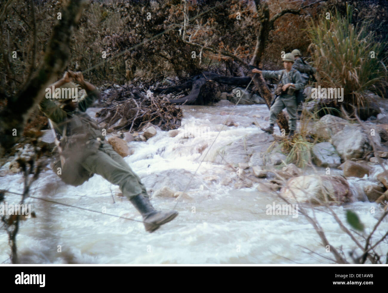 Vietnam War 1957 - 1975, American soldiers on patrol, crossing a river, South Vietnam, 1965, almost impassable region, - Stock Image