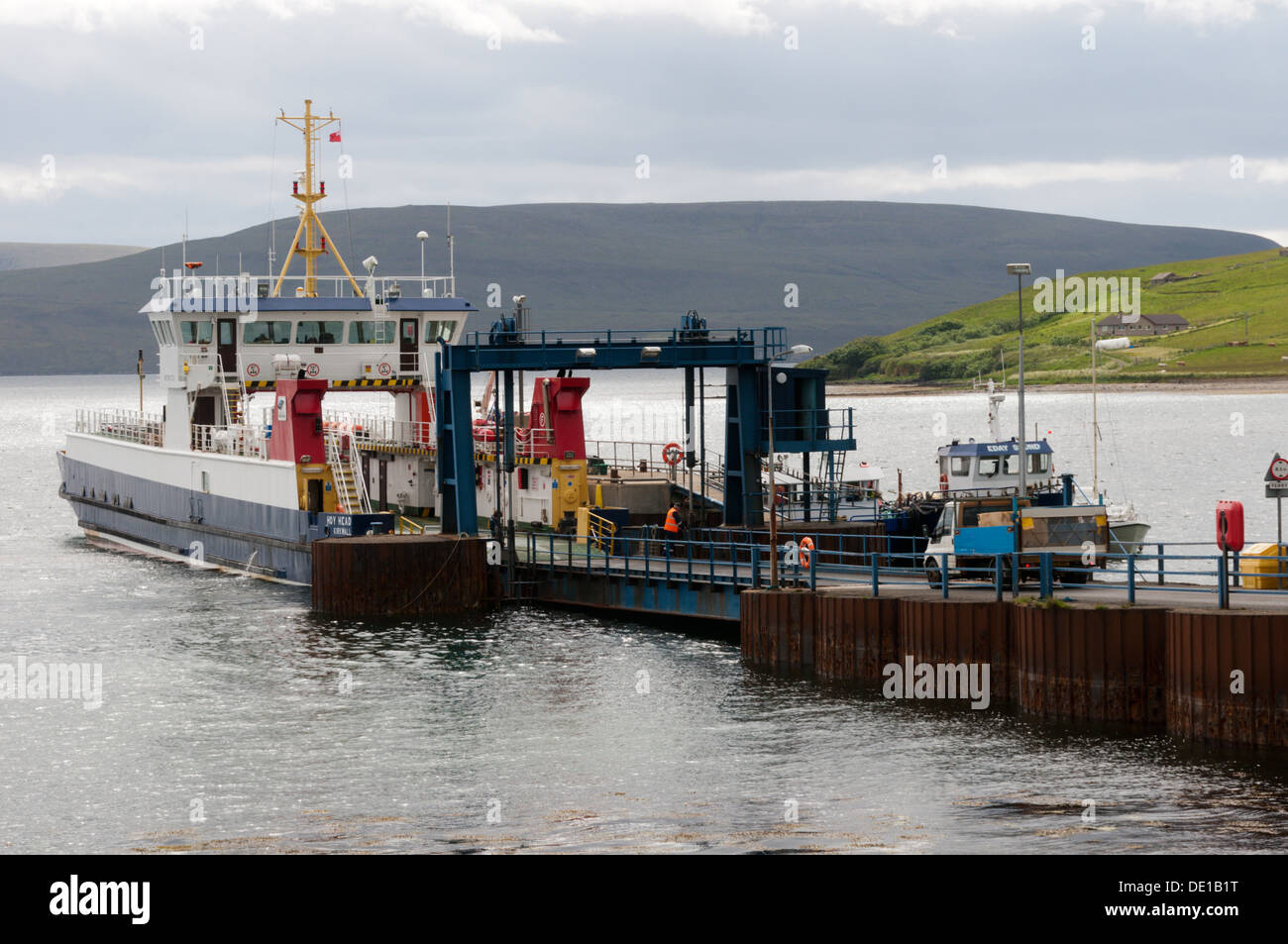 Local traffic boarding the MV Hoy Head at Houton Ferry Terminal on Orkney Mainland for the trip to Lyness on Hoy. - Stock Image