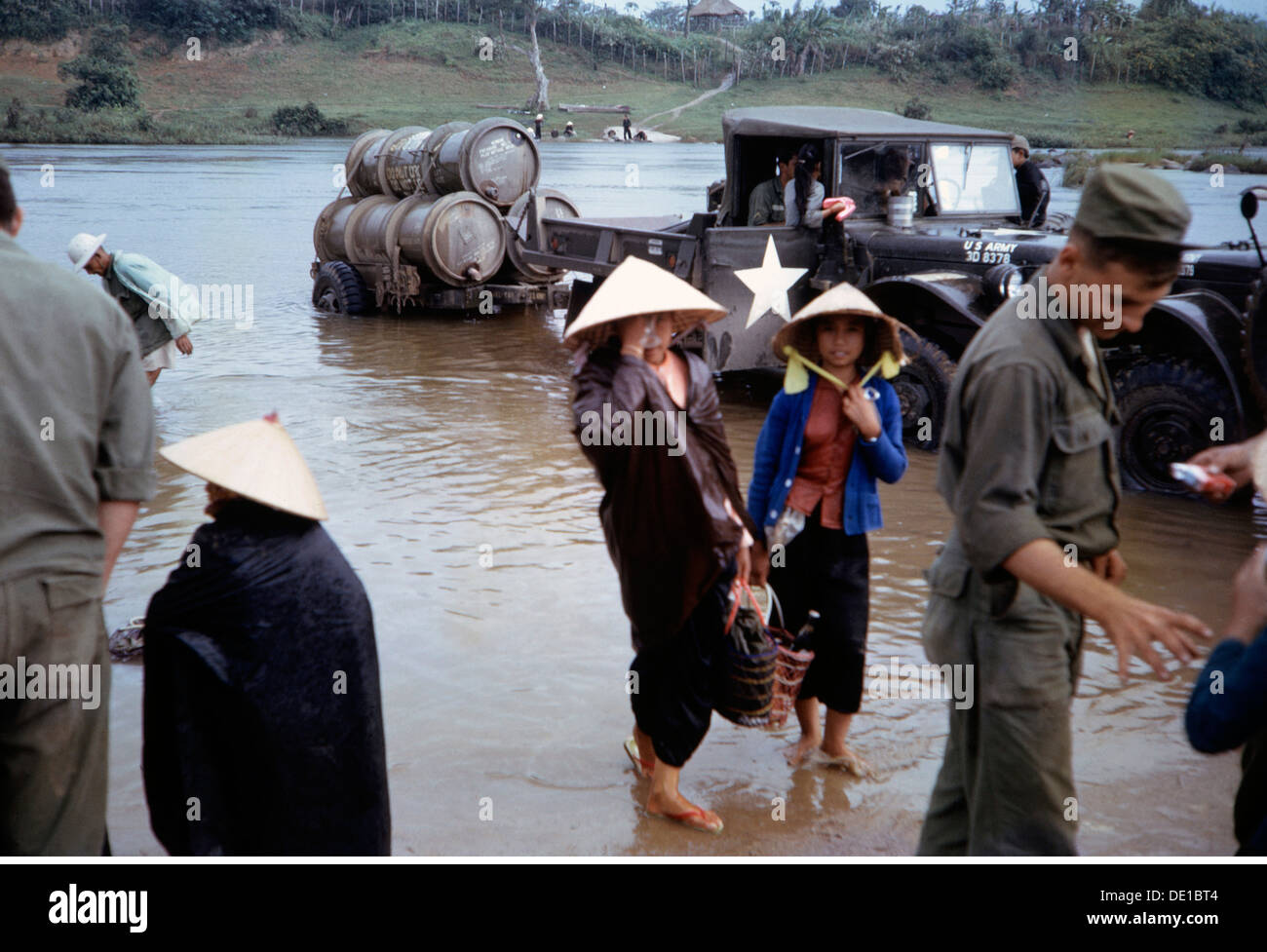 Vietnam War 1957 - 1975, young Vietnamese females and American soldiers at a ford, South Vietnam, 1965, civilian, - Stock Image