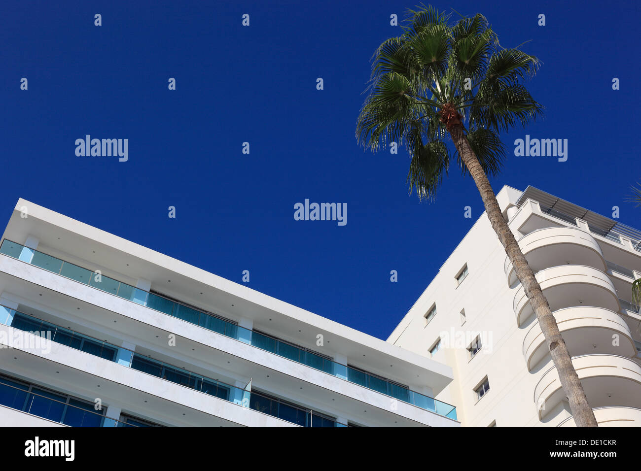 Cyprus, Larnaca, hotel, residential buildings, palm trees - Stock Image