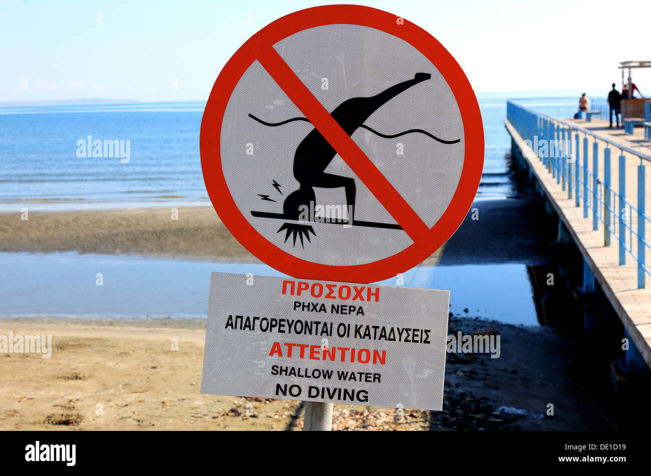 Jump Cyprus, beach, sea, prohibition sign, upside down into the water is prohibited - Stock Image