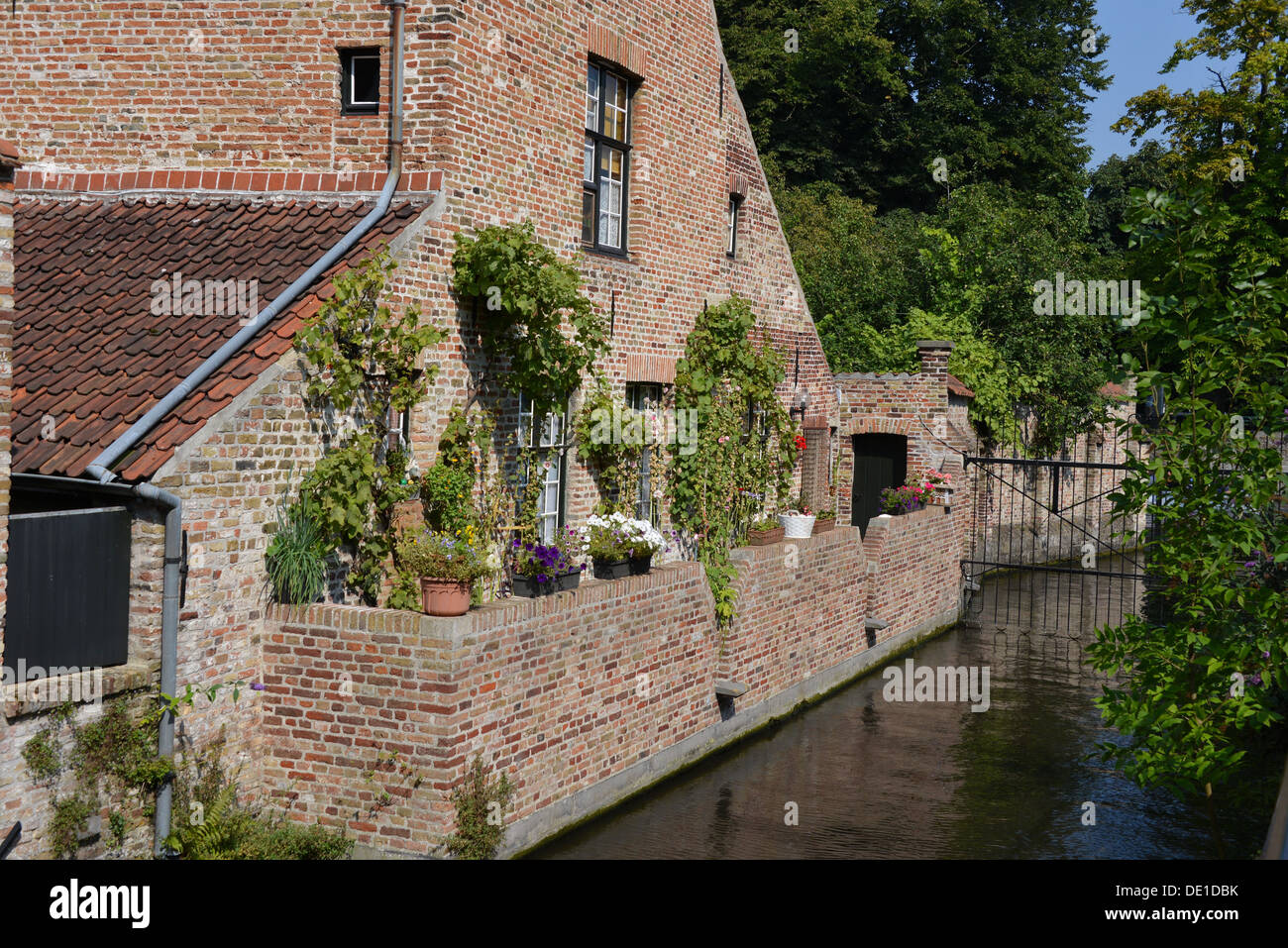 A house near a canal in Bruges, Belgium. - Stock Image