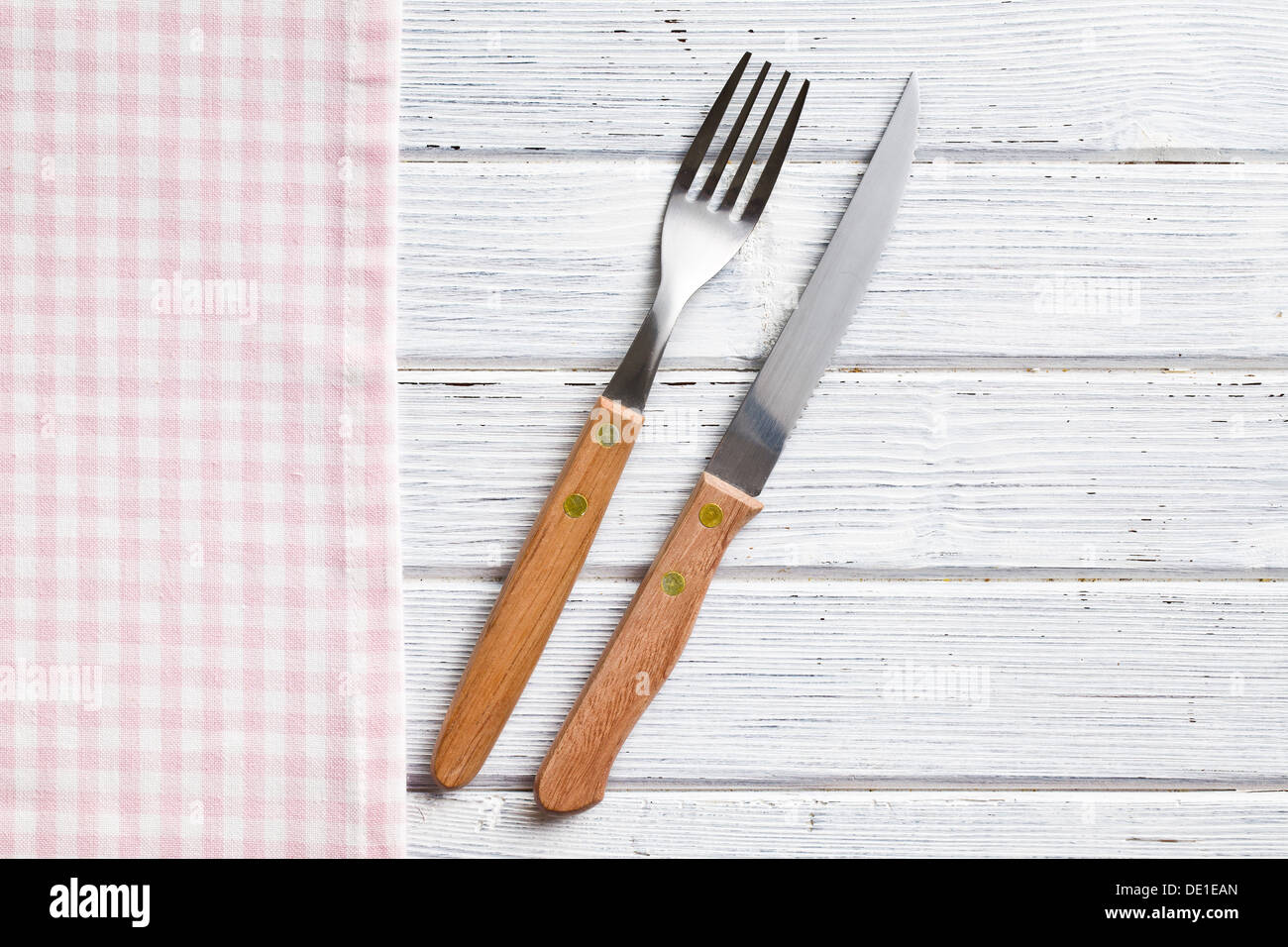 the knife and fork on wooden table - Stock Image