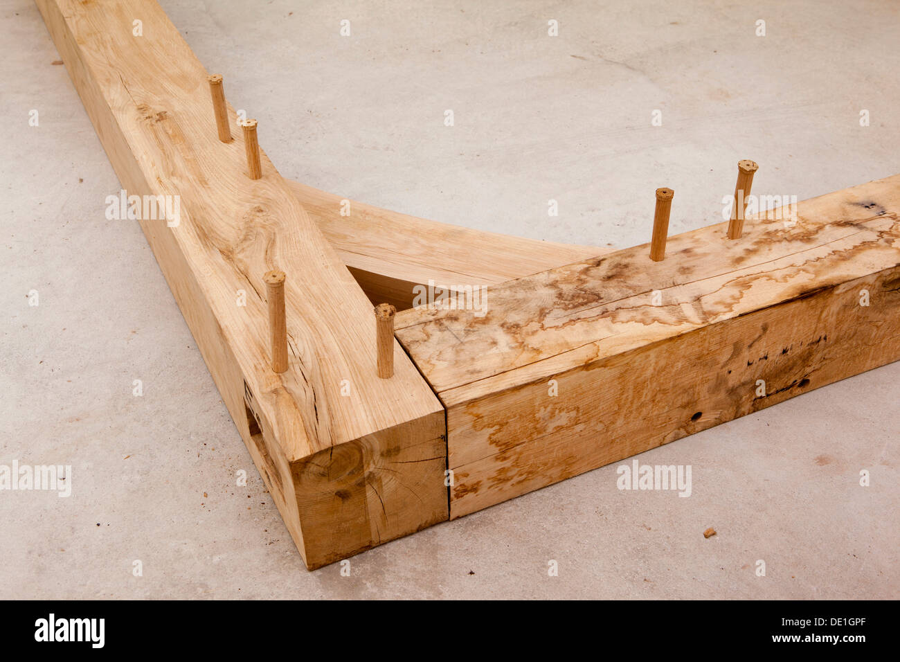 self building house, constructing green oak timber framed structure, pegged mortice and tenon joint and bracing - Stock Image