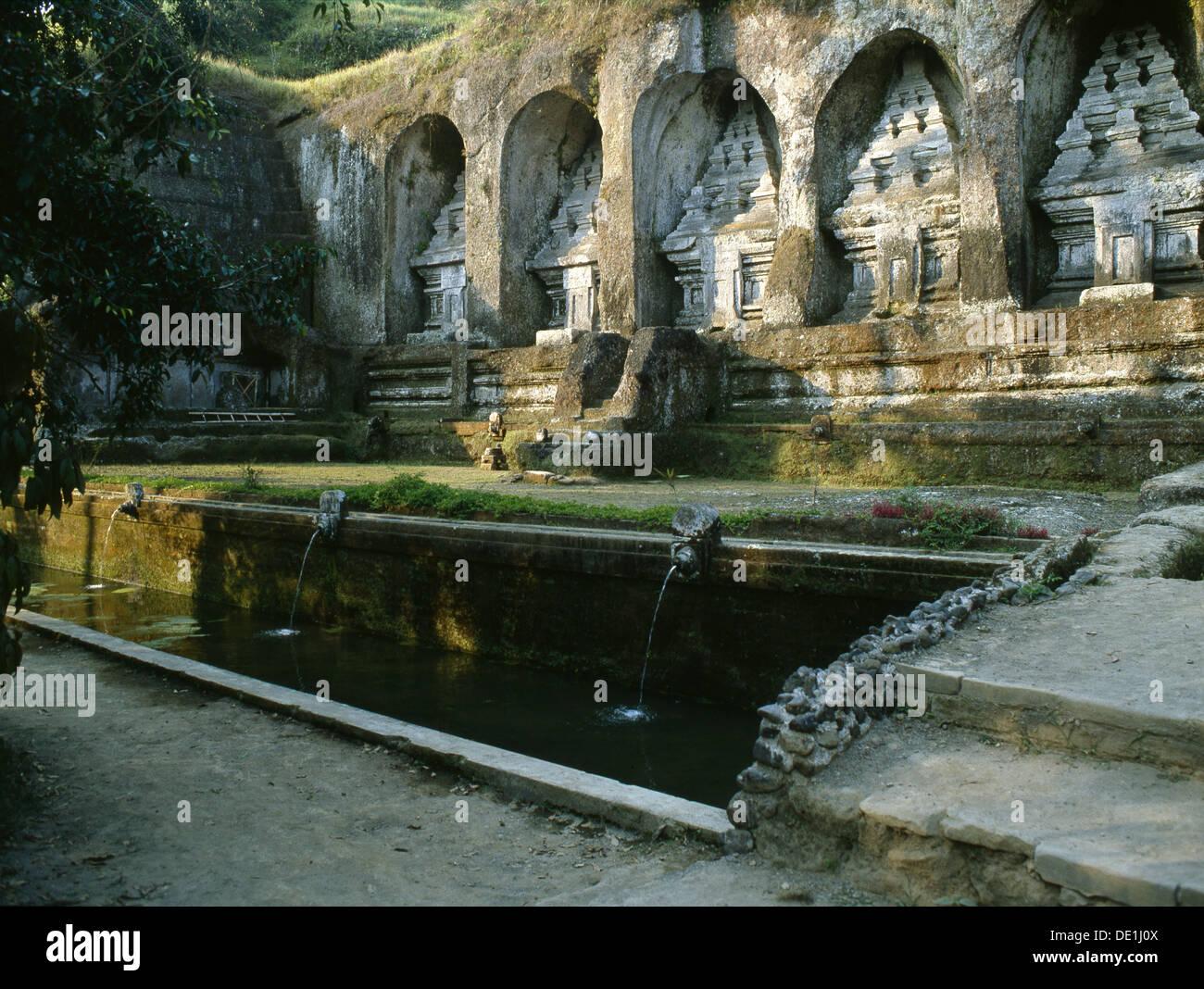 Candi, stone replicas of the cosmic mountain, at Gunung Kawi. - Stock Image
