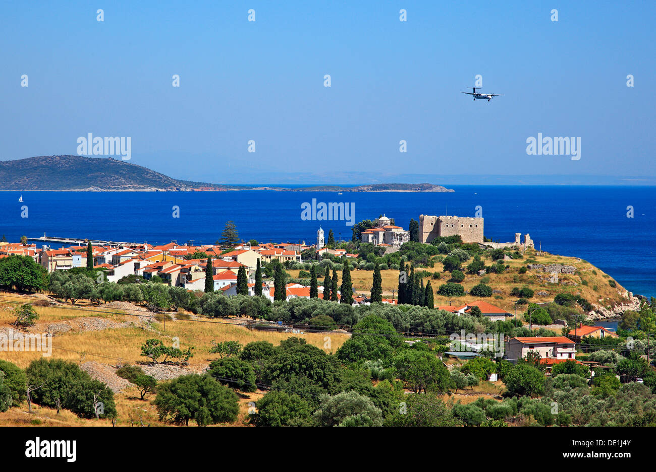 Panoramic view of Pythagorion town while an airplane is heading for landing at the nearby airport, Samos island, Stock Photo