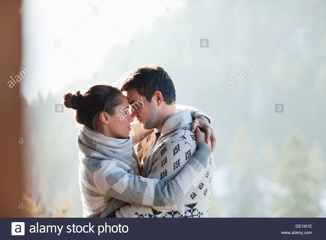 Couple hugging face to face outdoors - Stock Image