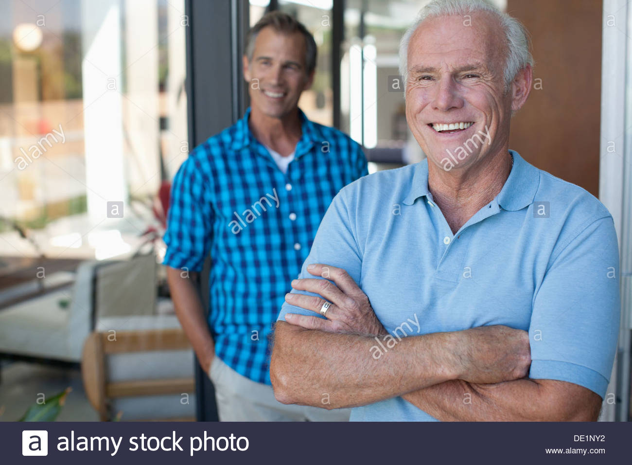 Father and son laughing outdoors - Stock Image