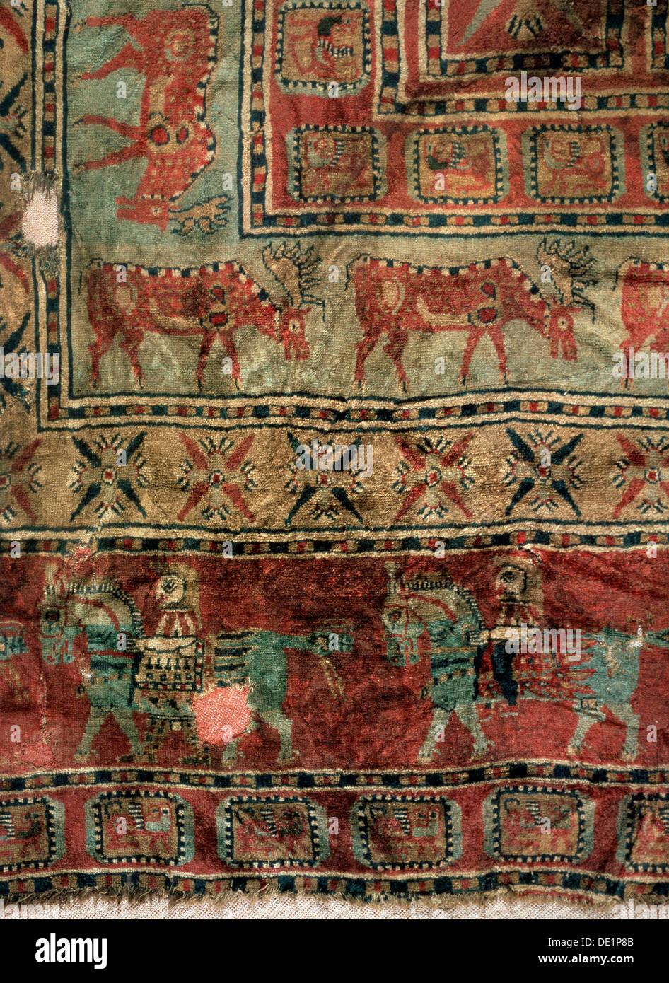 'Pile Carpet (Detail: Fallow deers and horsemen)', 5th-4th century BC. - Stock Image
