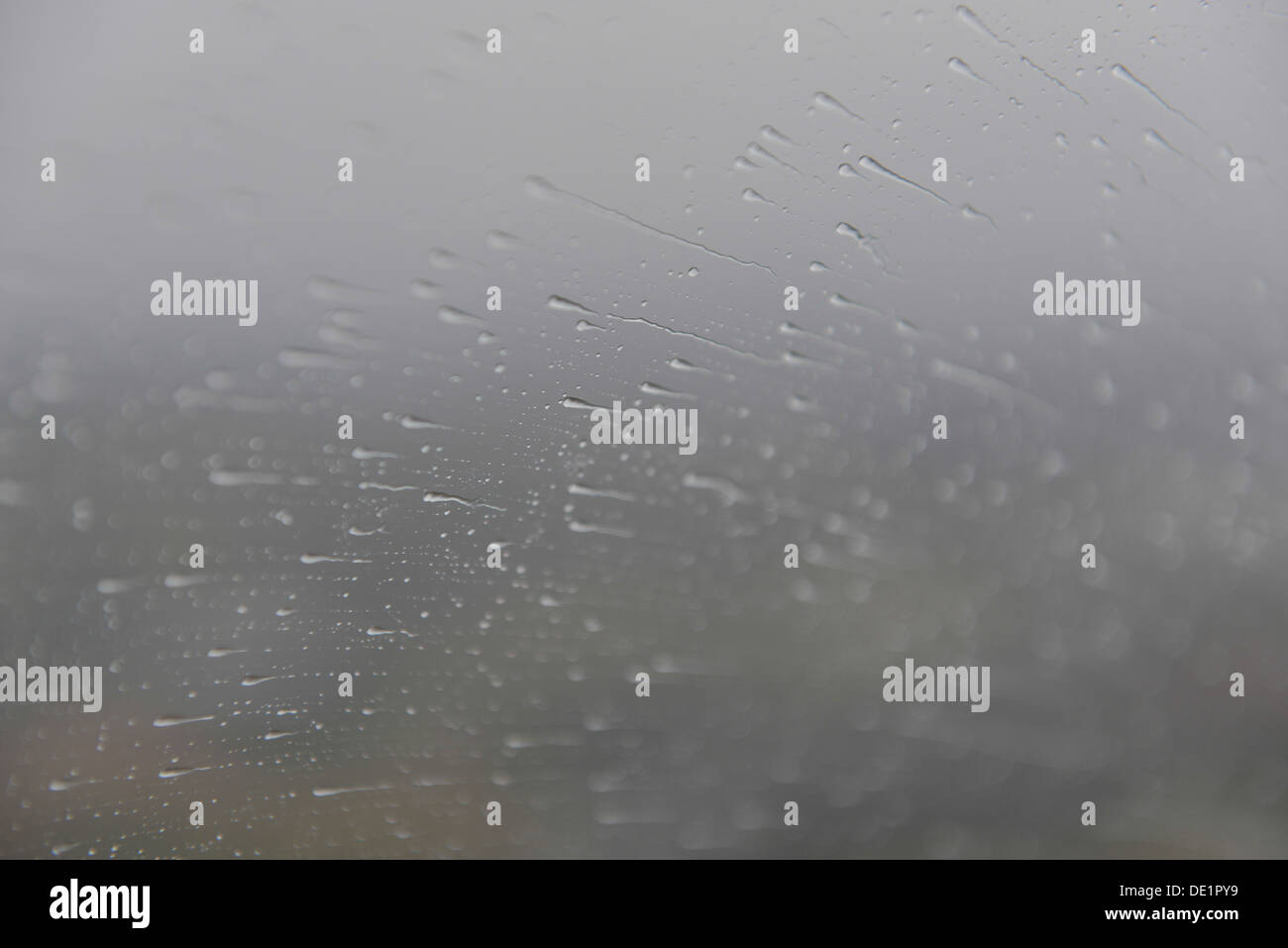 A photograph of rain streaming across a helicopter window - Stock Image