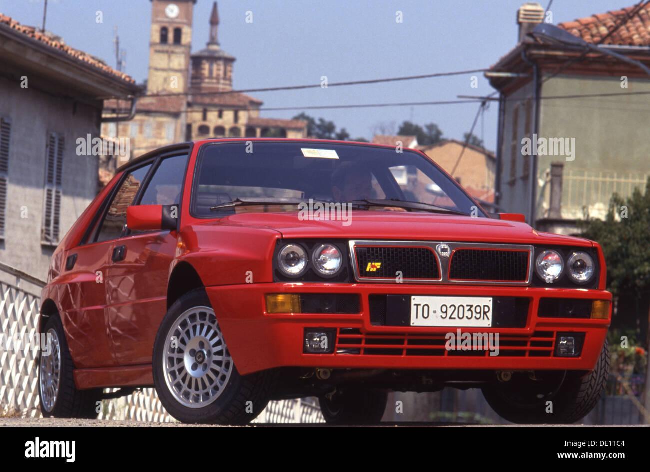 lancia delta integrale hf sports car 4x4 4wd 1990s in red swiss