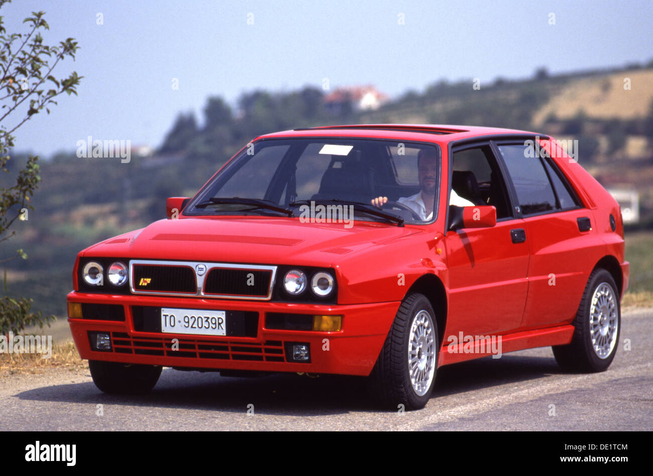 lancia delta integrale hf sports car 4x4 4wd 1990s - in red in swiss